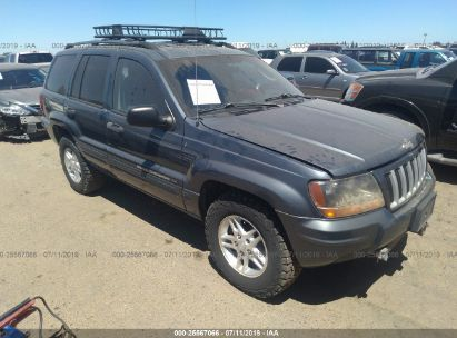 Salvage 2004 JEEP GRAND CHEROKEE for sale