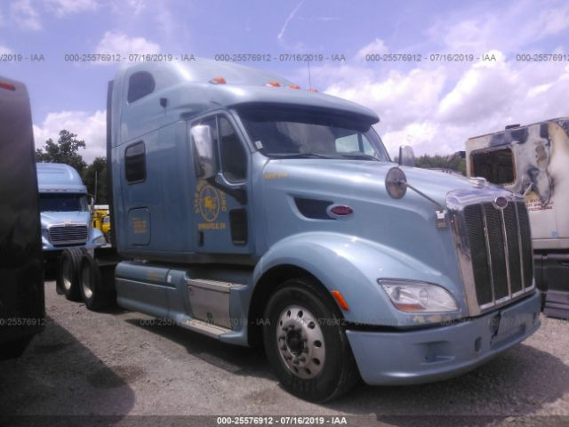 click here to view 2012 PETERBILT 587 at IBIDSAFELY
