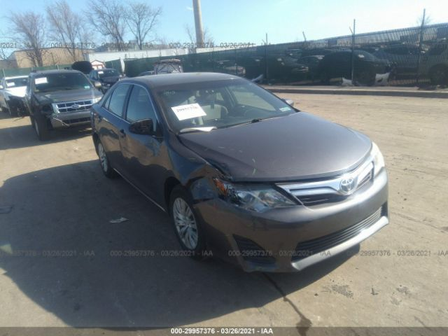 Salvage 2012 TOYOTA CAMRY - Small image. Stock# 29957376
